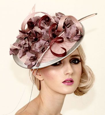 Judy Bentinck Under The Rainbow Pink Sinamay Disc with lilac shot silk flowers and colored quills.