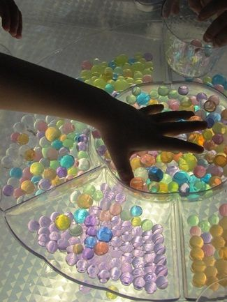 Teach Preschool | All About Water Beads/ clear dip and chip server is fun in the light box.