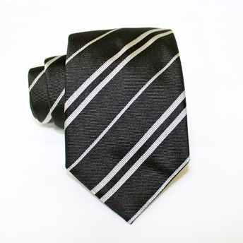 Jacquard tie, 100% silk, dark grey with single and double oblique white stripes. Ideal for less formal occasions but also special occasions. Pattern and color of this elegant tie can fit with any outfit.