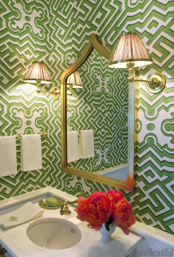 green and white chinoiserie wallpaper and gold accessories