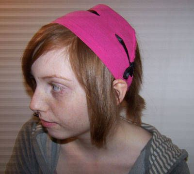 Make a headband out of a T-shirt sleeve.  Just a few simple steps.
