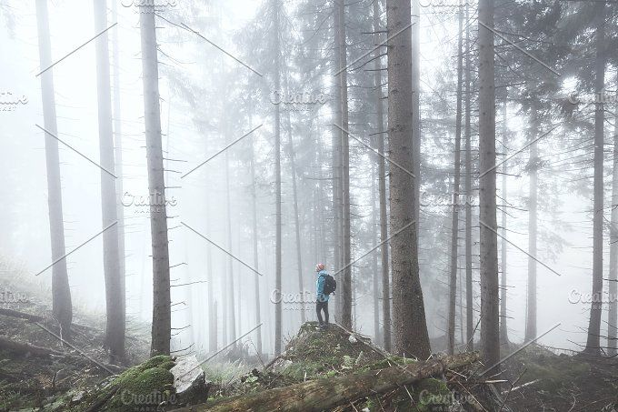 Hiker in misty forest by Sergey Furtaev on @creativemarket
