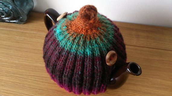 Cinnamon/plum/teal/spice hand knitted tea cosy with wooden
