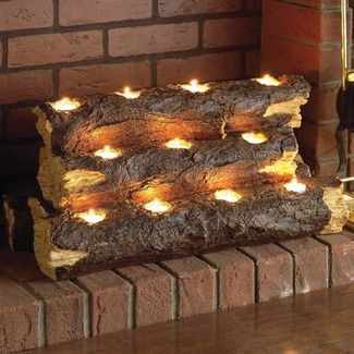 Tea lights in resin logs for the fireplace. I am thinking that the battery operated tea lights put in real logs might be an alternative look.