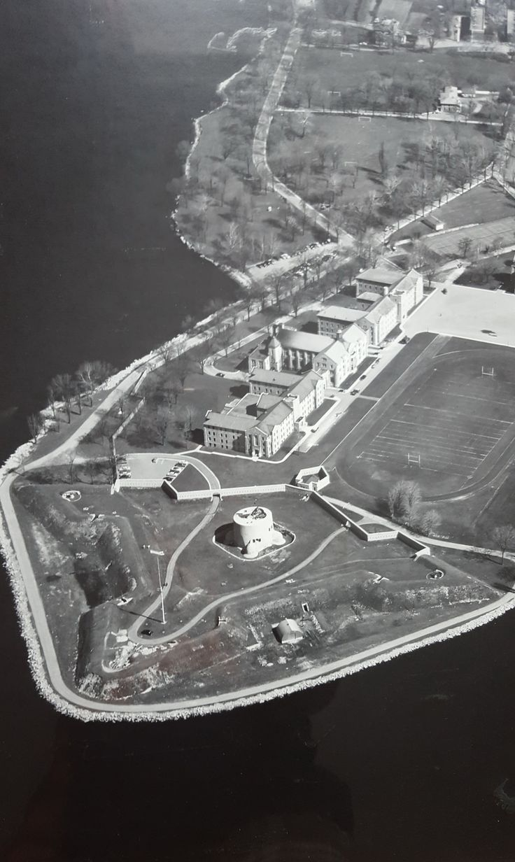 """https://flic.kr/p/D2wZ1T   Royal Military College of Canada Aerial Photograph   A framed undated aerial photograph of the Royal Military College of Canada, Point Frederick, Kingston, Ontario, Canada. The actual photo measures 33"""" x 26"""". There is a R.C.A.F. Photographic Establishment sticker in the lower right corner as shown. There is also a plot plan dated 1956 showing revisions to the College that have not yet been made. I am trying to date the photo and believe it is after F..."""