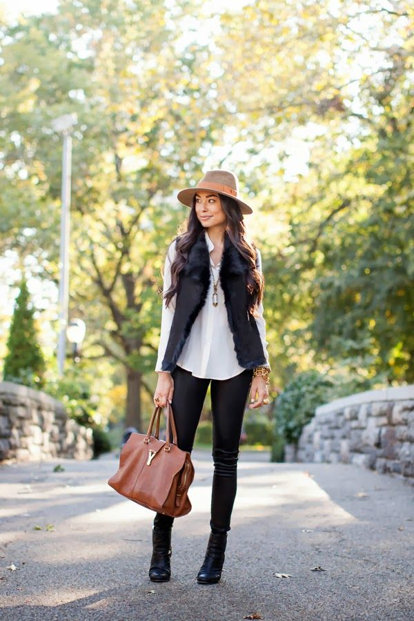 Get cozy with your neutrals. A shearling lined vest adds a touch of glam to a casual fall look.