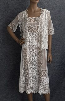 Hand-embroidered tulle tea dress, c.1923. The pristine white cotton tulle is as fresh today as when new. With soft feminine styling, pin tucks, handmade filet lace accents, and elaborate hand embroidery, the lovely dress delights the jaded modern eye. The elaborate handwork is to die for, especially the delicate filet lace and fine hand embroidery! The unstructured style is comfortable and easy to wear.
