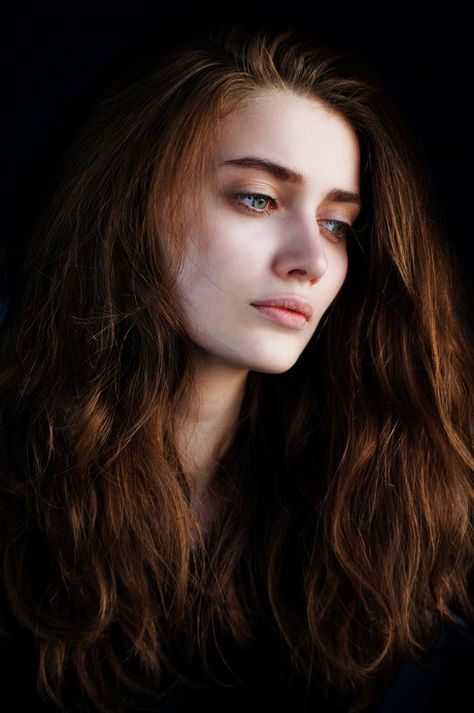 Cecelia was cold in the skin and in the eyes. Pale and blue until her hair shown in its deep nearly black sheen. It fell as the mountain against snow and ice.