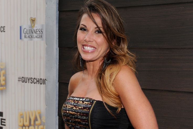 WWE lacks grip on reality with Mickie James return = Mickie James made her official return to the WWE main roster to an underwhelming, somewhat shocked murmur of the crowd, followed by…..