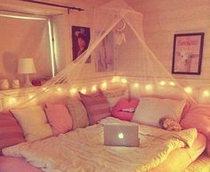 I love this idea with earth tones and without the tacky dream catcher. I would also do the lights overhead. But the pillows, love the pillows.