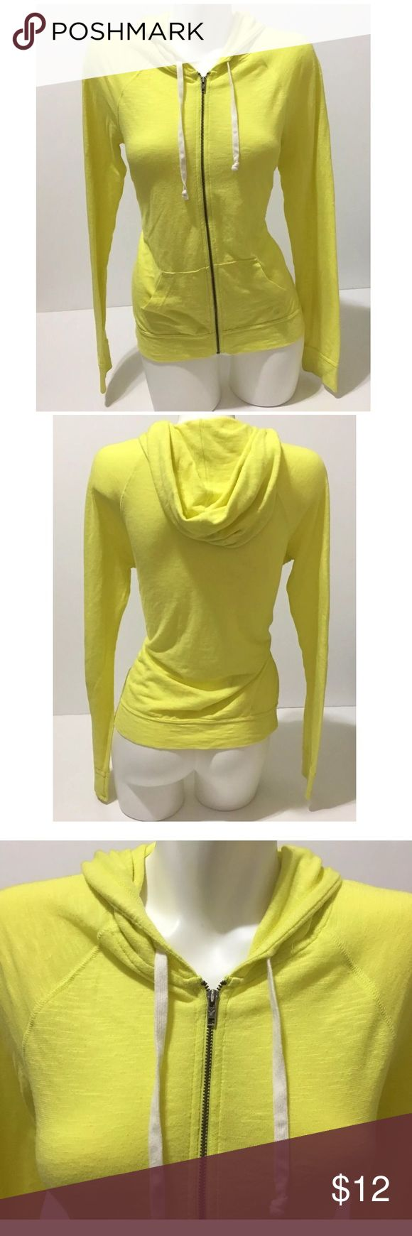 American Eagle Hoodie Sweatshirt Zip Yellow Large American Eagle Outfitters Womens Hoodie Sweatshirt Zip Up Yellow size Large  PLEASE NOTE- Small hole by pockets SHOWN IN PHOTO 6, light amount of pilling, in person this hoodie looks more brighter and more of a highlighter yellow color.  Length, Shoulder to Bottom: 23 inches Armpit to Armpit: 18 3/4 inches Armpit to end of Sleeve: 18 3/4 inches  Inventory# AP12 American Eagle Outfitters Tops Sweatshirts & Hoodies