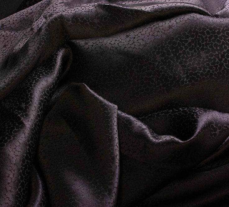Шелк черный с аниммалистичными узорами