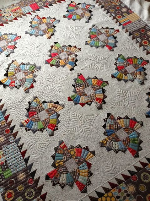 Twirling Fans Quilt. Design by Sharon of Fabrics & flowers, quilting by Jenny of Sew wonderful.