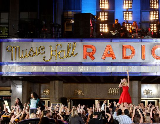 "Taylor Swift performs ""You Belong To Me"" outside of Radio City Music Hall at the 2009 MTV Video Music Awards.  #taylor swift#00s#90s#2009#throwback#memories#childhood#music#pop culture#mainstream#radio music#red dress#style#iconic#dress#inspiration"