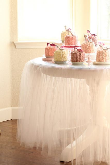 Individual cakes with pumps, pink & tulle tablecloth...so girly! :)