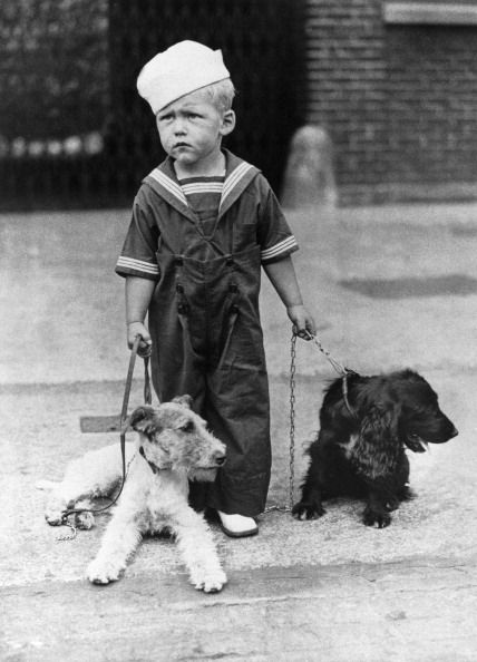 A Little Boy Dressed As A Sailor Holding Two Dogs On A Leash, A Fox-Terrier And A Cocker, In The Street Between 1940 And 1970. (Photo by Keystone-France/Gamma-Keystone via Getty Images)