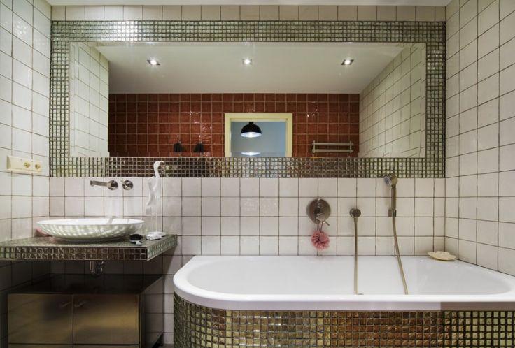Emerald bathroom with handmade glazed tiles.