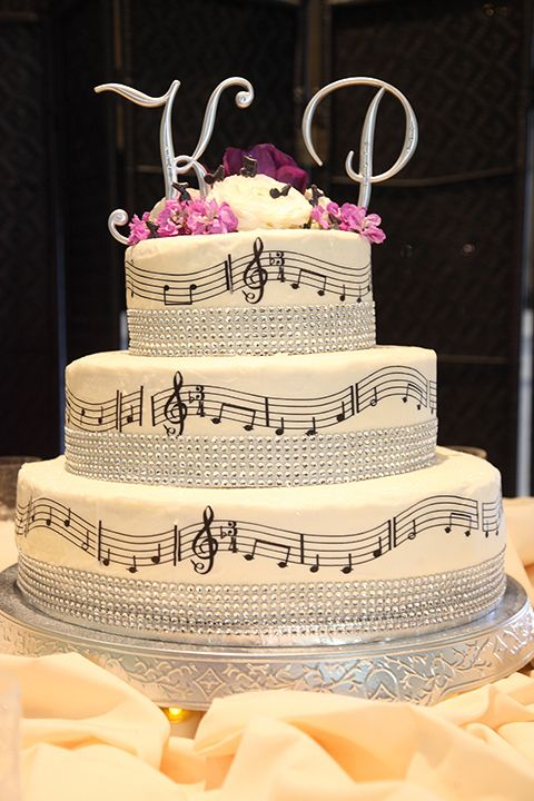 Musical notes themed wedding cake. Cause we both love music :)