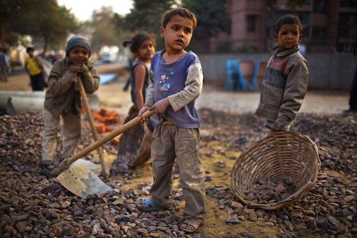 World Day Against Child Labor - The Atlantic (Indian children work alongside their parents at a construction project in New Delhi. India remains home to the greatest number of child laborers in the world despite efforts by successive governments to address the problem through compulsory education and anti-poverty programs.)