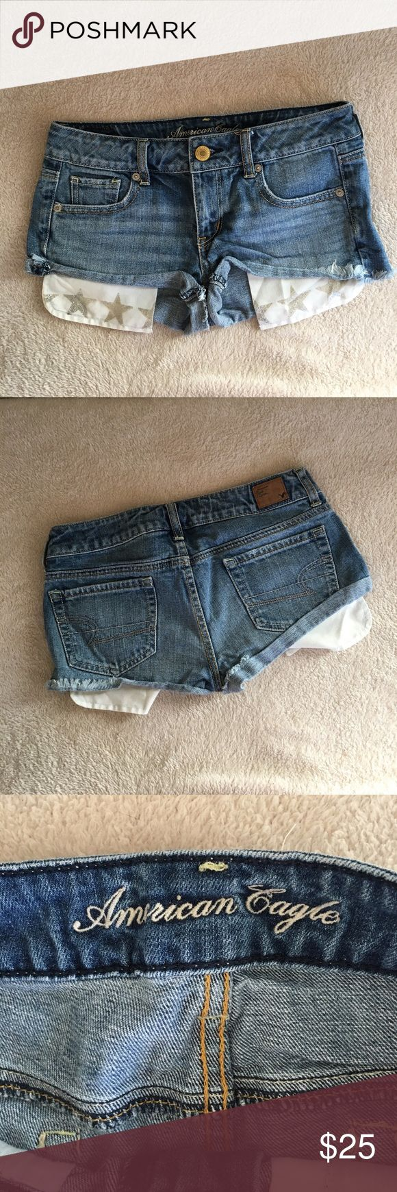 American eagle shorts American eagle brand size 2 Jean shorts size with stars on the bottom of the pockets. Waist is 30 inches front rise is 7 inches back rise is 12 inches. 100% cotton. Excellent condition American Eagle Outfitters Shorts Jean Shorts