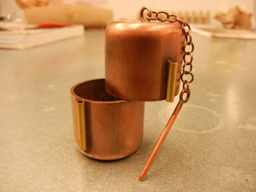 little copper & brass box with a swivel hinge and a pin clasp