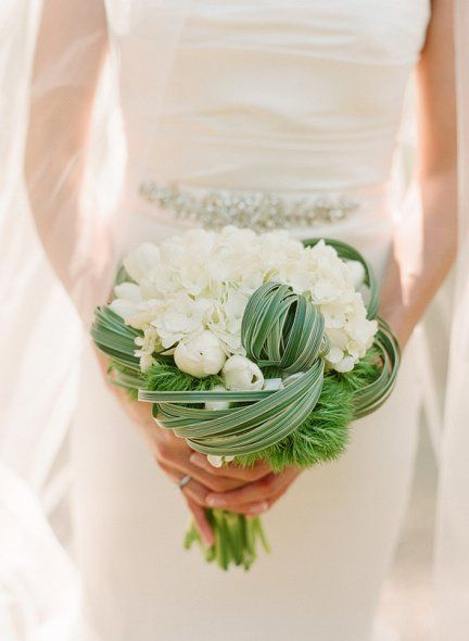 Such a simple selection of flowers: tulips, hydrangea, and green dianthus...but the variegated grass loops kick it up 10 notches! #wedding #bouquet