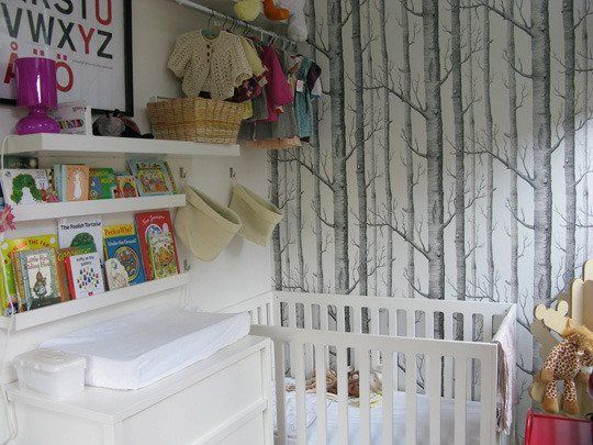 "Cole and Sons ""Woods"" wallpaper in Elsa's nursery"