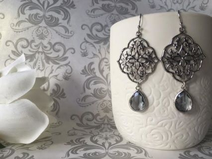 Beautiful filigrees are paired with dainty Grey stone bezels. Rhodium plated, tarnish resistant.  Wear them anytime or for those special occasions.  Stunning   A Beautiful gift for that someone or just wear them because you can.  Earwires are matte Silver plated over brass. approx 5cm top of the earwires  to bottom, tarnish resistant  All Savannah Rose Jewellery is lovingly handmade just for you from my wee home studio.  Enjoy!   Quantity