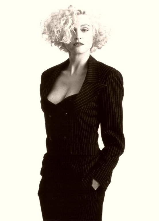 One of my favorites of her hairstyles -- I would love a big wavy/curly bob someday. Madonna - Shot by Herb Ritts
