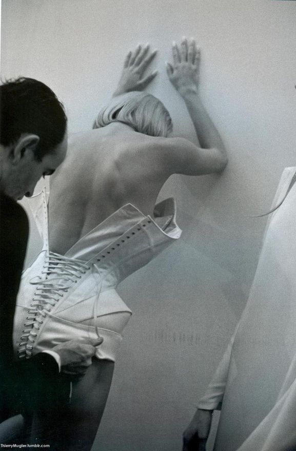 Mr. Pearl laces up a corset. Thierry Mugler 1998