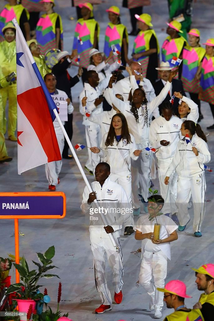Flag bearer Alonso Edward of Panama leads his team during the Opening Ceremony…