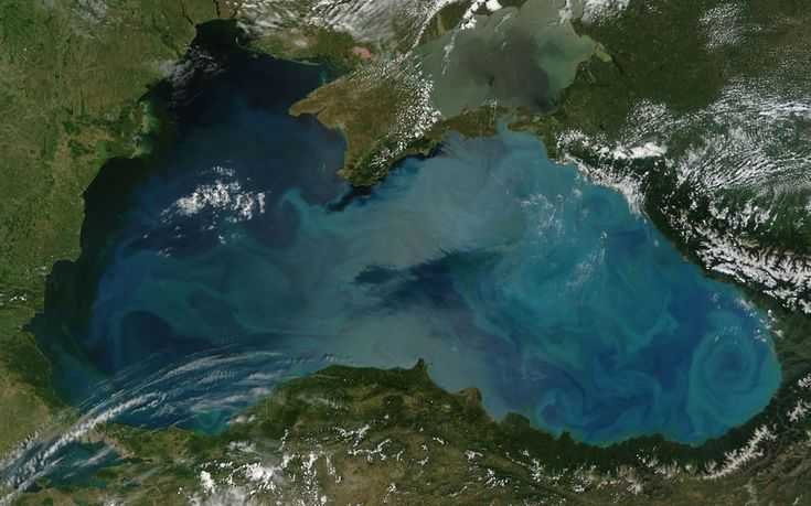 """""""An intense bloom of phytoplankton is seen in the Black Se, staining it with a rich palette of teal, turquoise, green and milky blue. The Moderate Resolution Imaging Spectroradiometer (MODIS) aboard the Terra satellite acquired this true-colour image on June 3rd, 2012."""""""