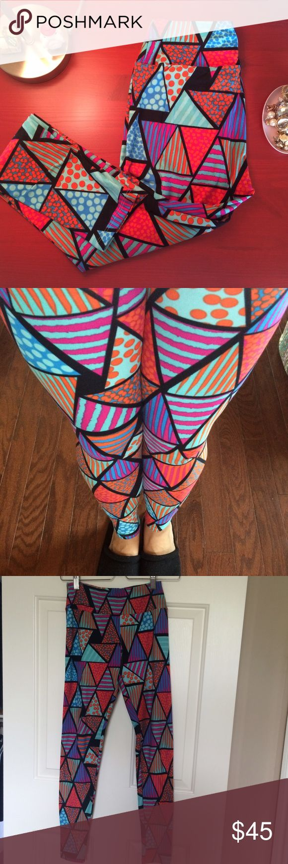 Patterned triangle leggings Rare LuLaRoe butter soft leggings with funky triangle pattern. 92% polyester, 8% spandex. Taken out of the package and tried on only for photo. This design is particularly hard to find. OS leggings will fit 0-12. LuLaRoe Pants Leggings