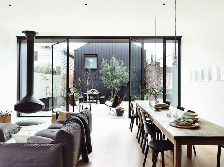 terrace as an extension of living room. black window frames