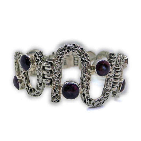 Brazalete Onda Púrpura. Brazalete de plata de ley y spondylus en forma de onda infinita. www.ccusi.com