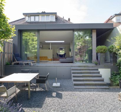 Another nice house-extension, this time to a 30s semi-detached house. Huge aluminium sliding doors and a stair to the garden. Design by 030 Architecten. Photography by Klaarlicht.
