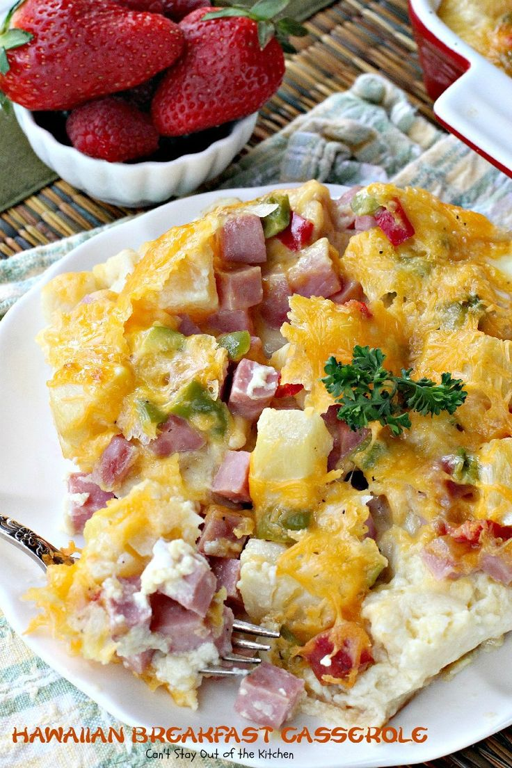This delicious breakfast casserole uses King's Hawaiian Sweet Rolls, ham, pineapple, red and green bell peppers, onions and cheese in a scrumptious souffle-type dish. Great for holiday breakfasts.