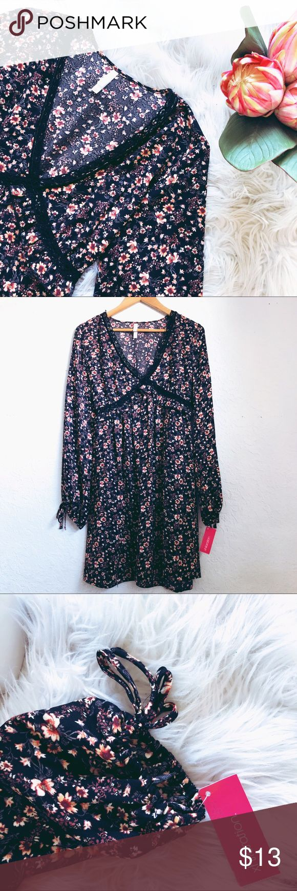 Floral Dress Brand new with tags! Perfect boho dress to pair with short booties and shown! Could also be paired with tights for the winter time. Please let me know if you have any further questions! Xhilaration Dresses Midi