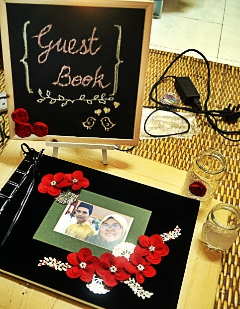 Handmade Wedding Guest Book and the signage.  Mason jar as the additional deco.