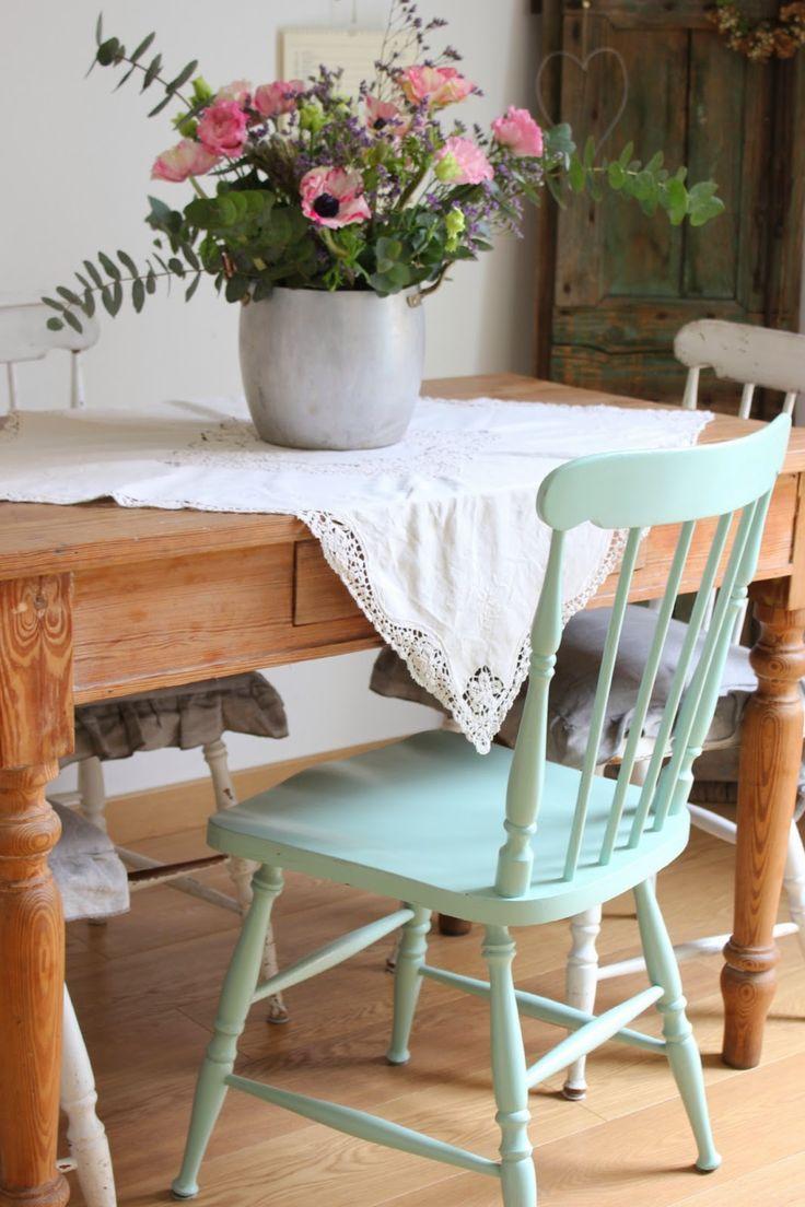 tablecloth at an angle, silver pot