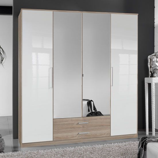 Add variation to your #room with Gastineau 4 door #wardrobe in oak. It has 2 mirrors and 2 #drawers to add versatile storage option in your bedroom.