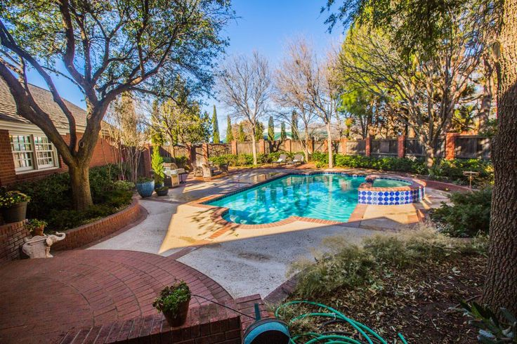 Remarkable 4/4.5/3 with basement, casual elegance with wonderful views of pool area, lush backyard, Chef's kitchen 6 burner wolf gas commercial stove, Subzero refrigerator, wine refrigerator, wood floors, 3 bedrooms w/ own bathrooms upstairs, office w/ fireplace, elegant master suite. This home speaks for itself!