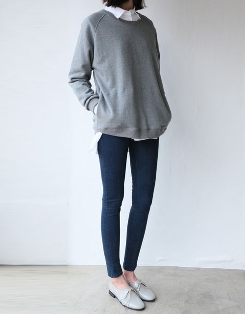 I like this -- the oversized sweater and button down underneath with skinnies. The shoes work too.