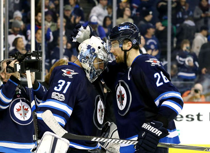 WINNIPEG, MB - JANUARY 21: Goaltender Ondrej Pavelec #31 and Blake Wheeler #26 of the Winnipeg Jets celebrate a 5-3 victory over the St. Louis Blues at the MTS Centre on January 21, 2017 in Winnipeg, Manitoba, Canada. (Photo by Darcy Finley/NHLI via Getty Images)
