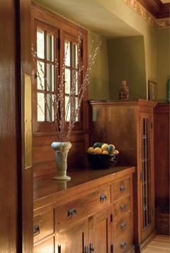 Love the woodwork against the green wall color