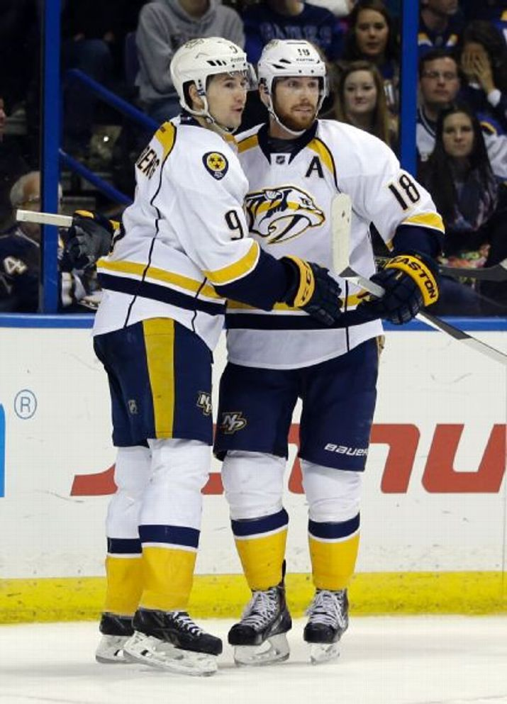 Nashville Predators' James Neal, right, is congratulated by teammate Filip Forsberg, of Sweden, after scoring during the third period of an NHL hockey game against the St. Louis Blues, Saturday, Nov. 8, 2014