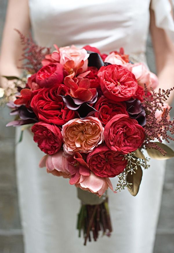 slightly asymmetrical red, pink and mauve bouquet.