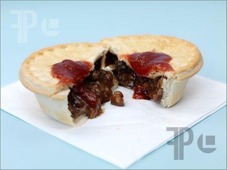 Australian meat pie and tomato sauce