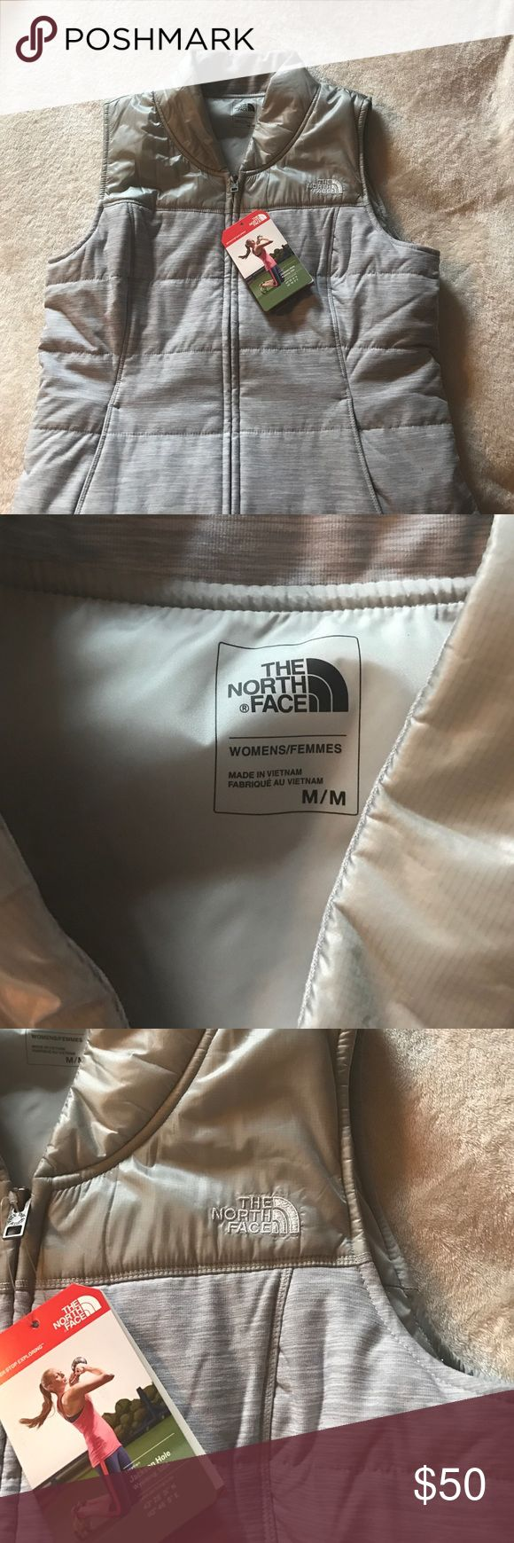 NWT The North Face Vest NWT North face vest! Beautiful gray color! Light weight, perfect for spring!!! The North Face Jackets & Coats