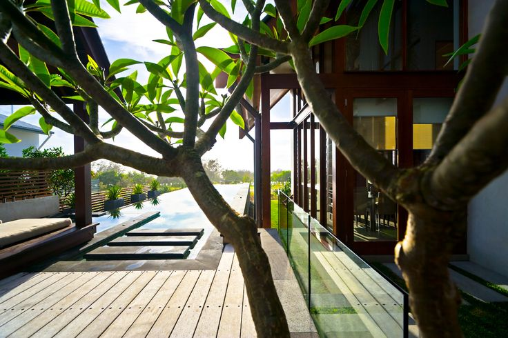 Beach-front, Balinese inspired, family home located in Salt Village, Kingscliff, New South Wales, Australia. Built by Seabreeze Homes. Designed by Grounds Kent Architects.